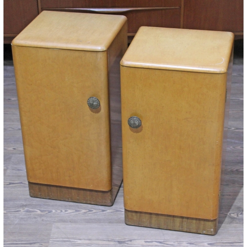 28 - A pair of 1950s Art Deco bird's eye maple veneered bedside cabinets, height 69cm....