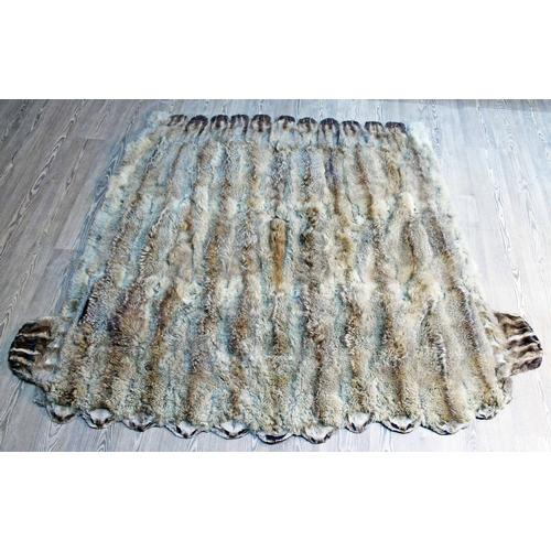 33 - A large fur rug 173cm x 198cm....