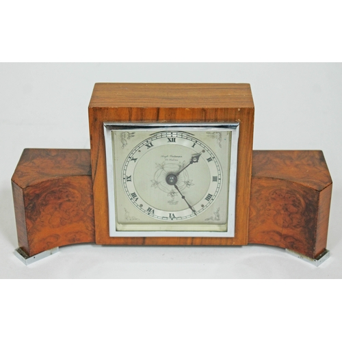39 - An Art Deco chrome mounted walnut mantle clock by Elliott, length 26cm....