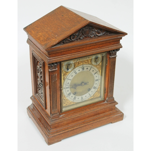 42 - An architectural oak mantle clock by Winterhalder and Hoffmeir, height 40.5cm....