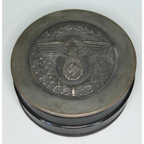 A German Nazi snuff box of circular form with mounted eagle and