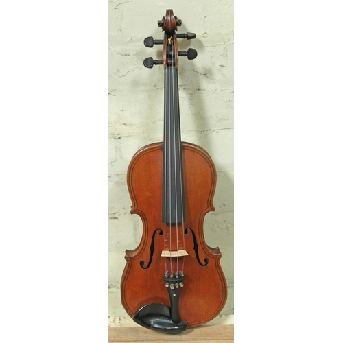 44 - A late 19th century violin labelled 'Maggini Deutsche Arbeit 1886', length of back 36.5cm, with bow ...