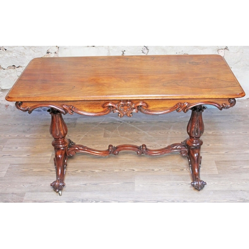 6 - A 19th century rosewood writing table having moulded scroll frieze, pedestal legs supported by scrol...