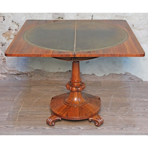 7 - A William IV rosewood fold over card table, tooled leather interior, turned pedestal with round plat...