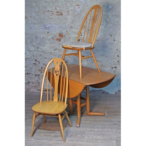9 - An Ercol blonde elm and beech Campden 955 drop leaf table and two swan back chairs....