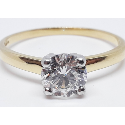 99 - A diamond solitaire ring, the round brilliant cut 1.74 carat diamond in four claw setting, band hall...