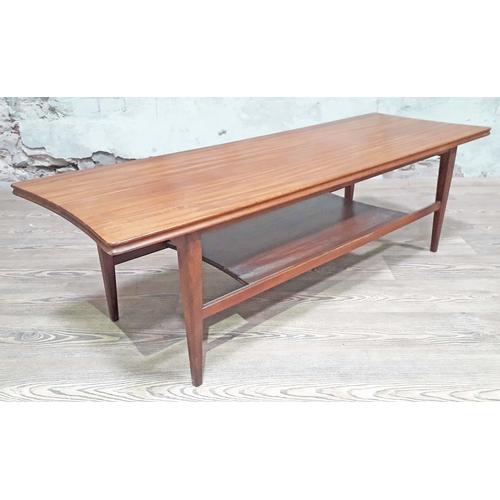 17 - A Danish style two tier teak coffee table, length 121cm, depth 41cm & height 36cm....