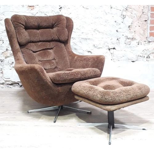 18 - A retro brown velour egg chair and matching stool. (This item may not comply with the Furniture and ...