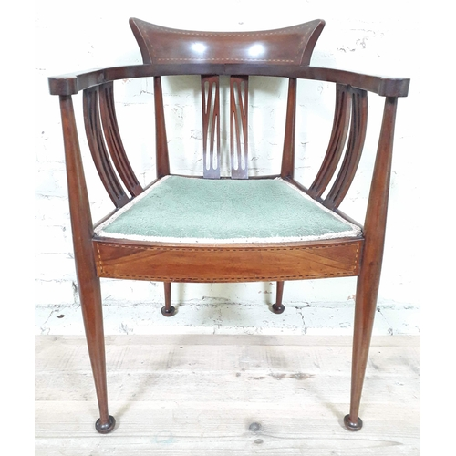 23 - An Edwardian Arts & Crafts parquetry inlaid mahogany armchair with pierced and bowed slats, shaped b...