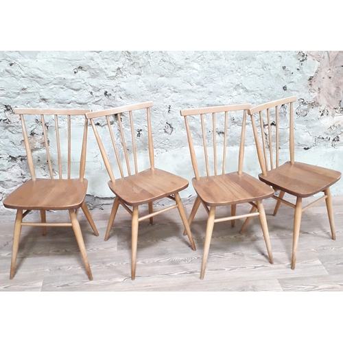 24 - A set of four Ercol blonde elm and beech chairs....