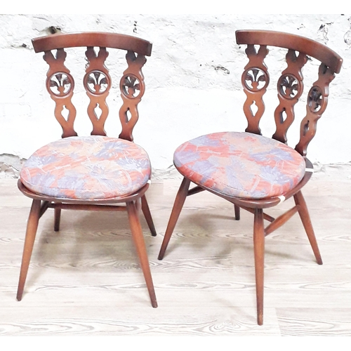 30 - A pair of Ercol Fleur De Lys dark elm and beech chairs....