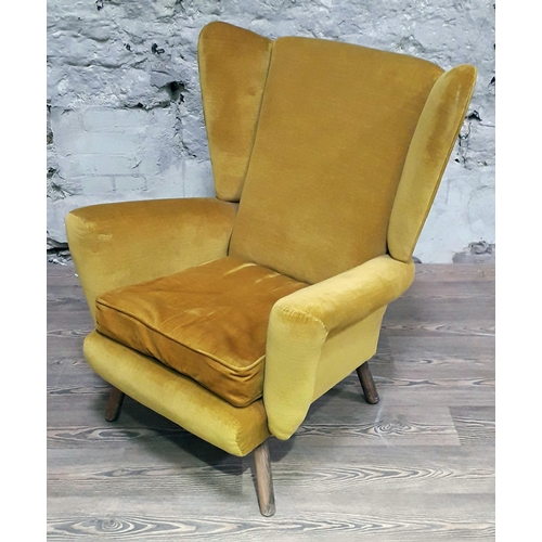 33 - A mid 20th century mustard yellow wing back armchair, width 80cm, depth 83cm & height 94cm....