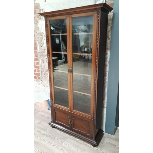 35 - An Edwardian glazed mahogany bookcase attributed to Shapland & Petter Barnstaple with applied bead w...