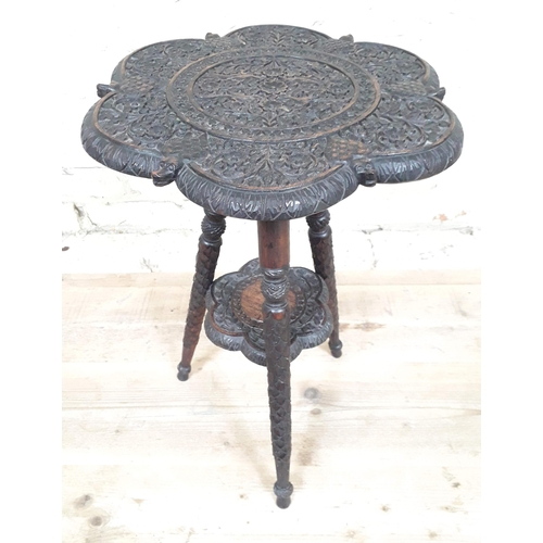 36 - An Indian profusely carved rosewood occasional table, diameter 39cm & height 55cm....