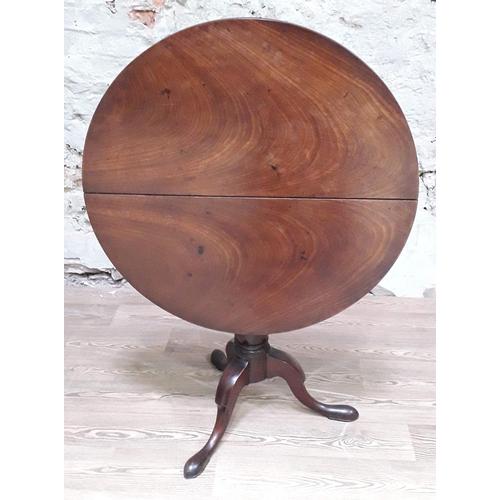 37 - A Georgian Honduras mahogany birdcage tripod table, diam. 83cm & height 73cm....