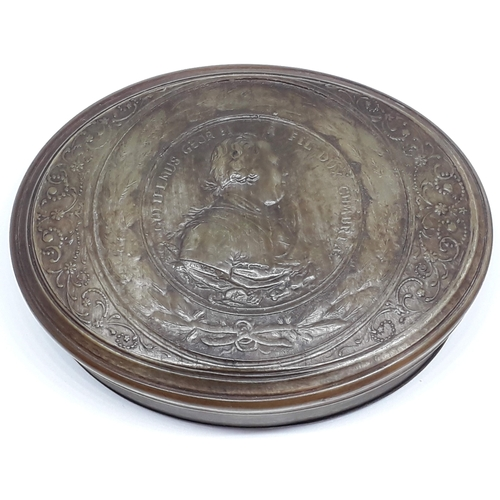 1 - An 18th century horn snuff box embossed with George II head in profile with wreath and floral border...