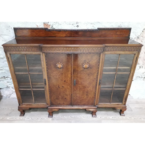 11 - A burr walnut breakfront bookcase by Waring and Gillows, length 155cm, depth 36cm & height 120cm....