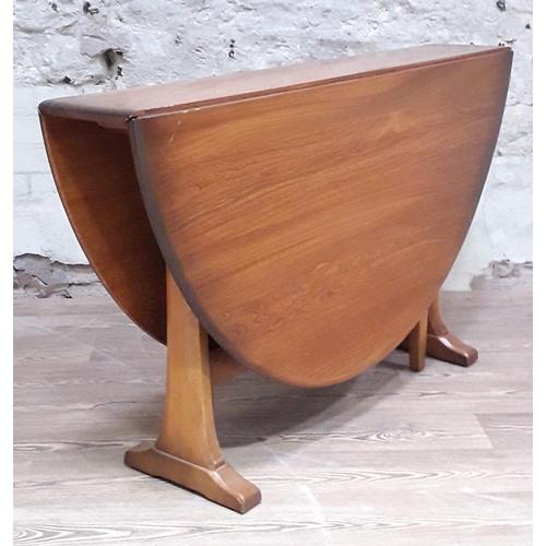 14 - An Ercol Golden Dawn drop leaf oval table, min. length 127.5cm, min. depth 29cm & height 71.5cm....