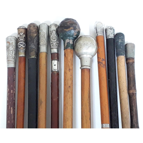 2 - A bundle of eleven swagger sticks, seven with regimental crests....