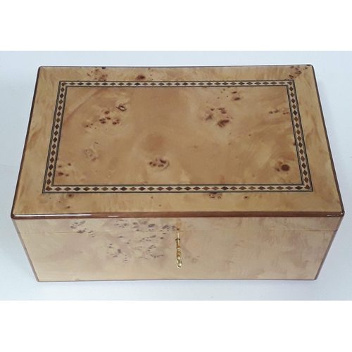 4 - A contemporary parquetry inlaid burr sycamore humidor with fitted interior and brass carry handles, ...