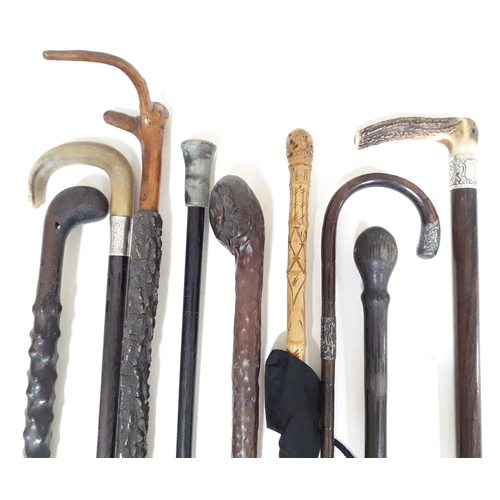 5 - A group of eight various walking sticks and one umbrella, various woods, mounts and handles....
