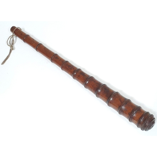 7 - A Victorian oak bamboo effect and weighted truncheon or cosh, length 39.5cm....