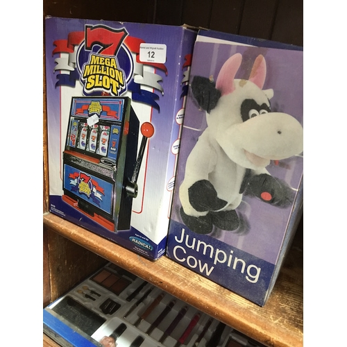12 - A Mega million slot machine toy and a jumping cow toy...