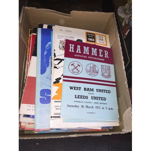 24 - A box of football programmes...