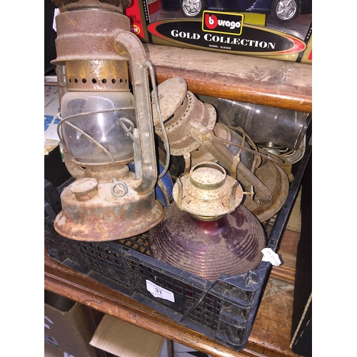 31 - A of box of paraffin lamps...