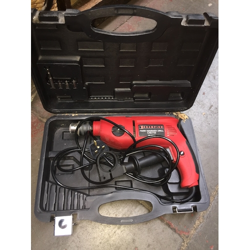 42 - A Champion 750W hammer drill in case...