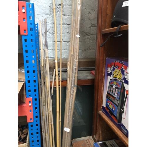 61 - A quantity of garden canes...