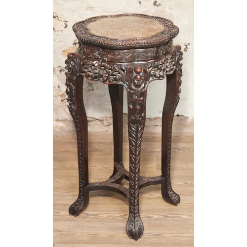 1 - A Chinese marble top carved hardwood plant stand, 19th century, height 92cm....