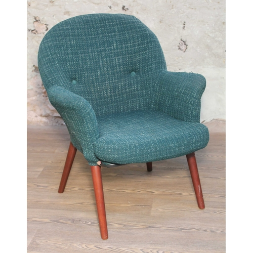 10 - A retro Toothill Wingate series armchair with spindle legs and original textured upholstery, width 6...