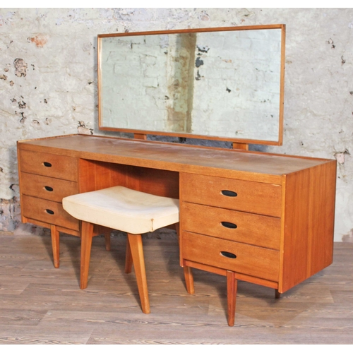 15 - An Austinsuite teak dressing table with adjustable mirror, cut-out handles and stool, length 168cm, ...