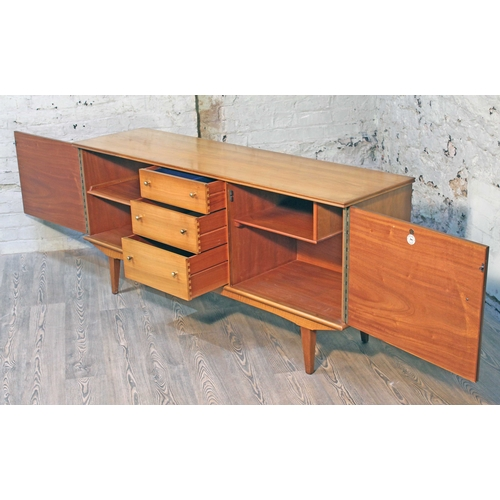 18 - An Alfred Cox Kenton sideboard for Heals, in French walnut with gilt brass knobs,