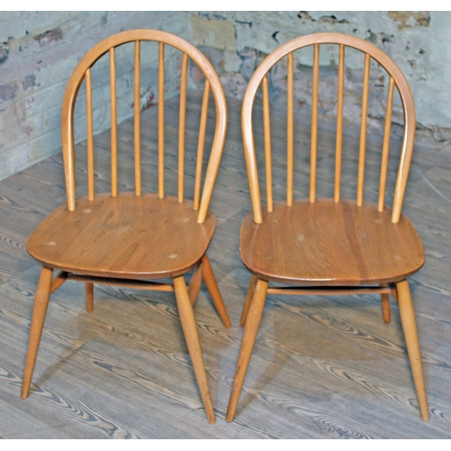 19 - A pair of Ercol Blonde elm and beech spindle back chairs....