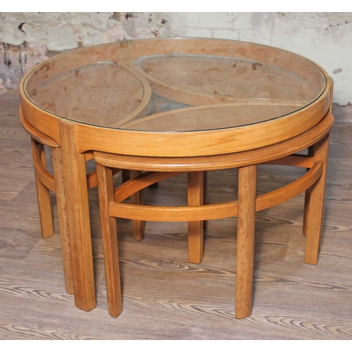 9 - A Nathan teak nest of tables with glass top, diam. 84cm & height 51cm....