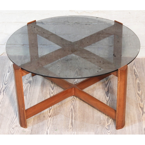 36 - A Myer teak and smoked glass top coffee table, diam. 76cm....