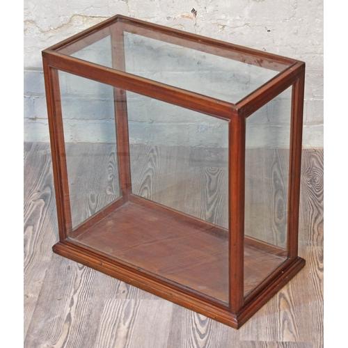 37 - A glass display case, length 59cm, depth 32cm & height 57cm....