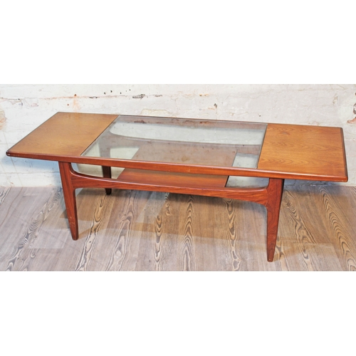 38 - A G-Plan teak and glass top coffee table....