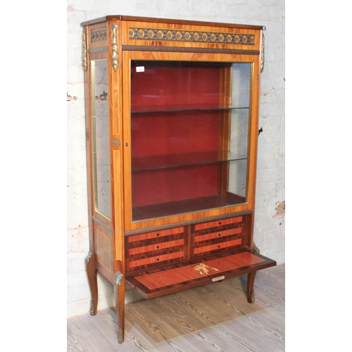 42 - A French style walnut cross banded and marquetry inlaid glazed cabinet with gilt metal mounts and lo...