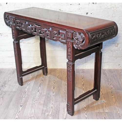 44 - A Chinese altar table, late 19th century, carved frieze with scroll ends and carved square legs, len...