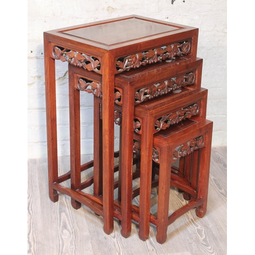 45 - A Chinese carved hardwood nest of tables, early 20th century, height 70cm....