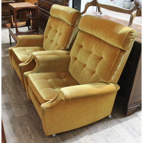48 - A pair of Parker Knoll model 30 retro reclining armchairs. (This item may not comply with the Furnit...