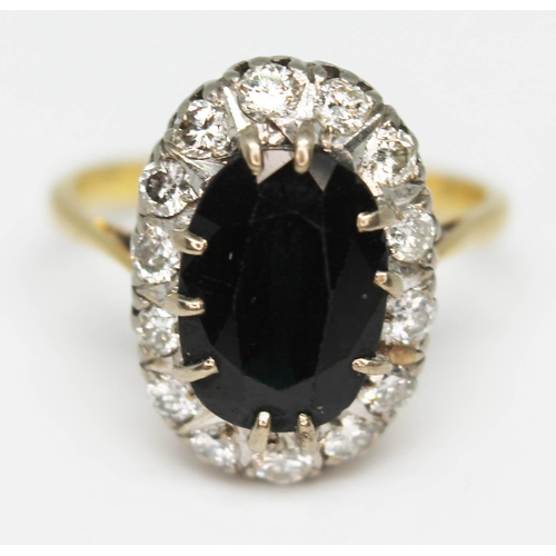 208 - A diamond sapphire cluster ring, band indistinctly marked '18ct', gross wt. 5.6g, size O....