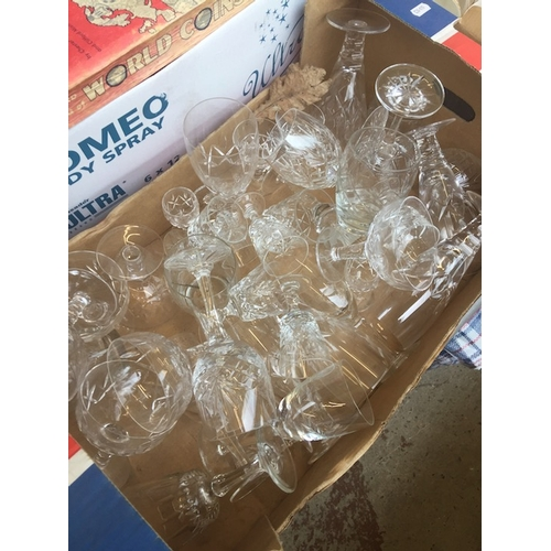 23 - A box of wine and drinking glasses...