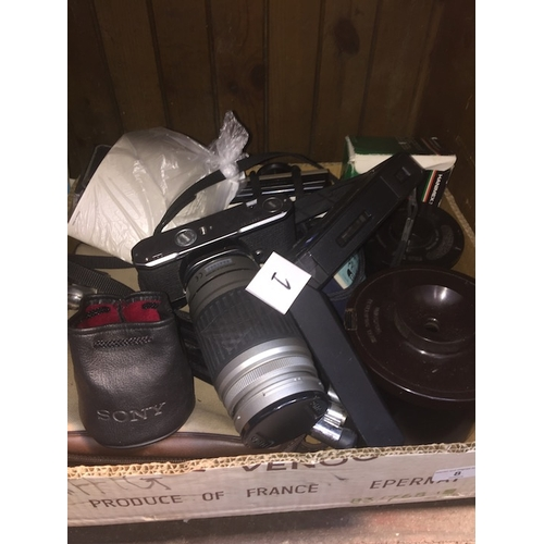 8 - A box of cameras and accessories to include Pentax, Canon, etc...