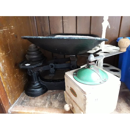 11 - A cast iron egg stand, a French coffee grinder and a set of vintage enamelled scales with weights...