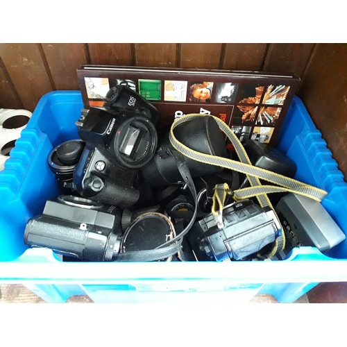 12 - A box of photography equipment, including Miranda, Canon, Zenit, etc...