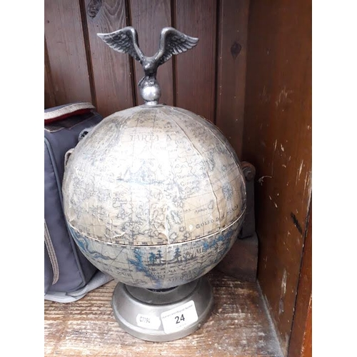 24 - A musical globe bar containing 6 amber coloured glasses and decanter having bird mounted on top, tog...